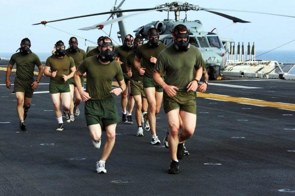 US_Navy_110429-M-IT398-103_Marines_run_while_wearing_M50_gas_masks_aboard_USS_Bataan_LHD_5-1
